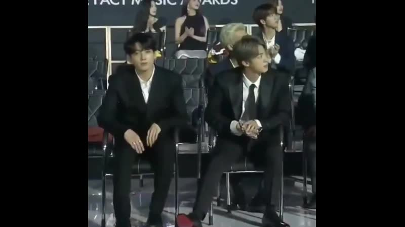 Jungkook giving hearts meanwhile jin fixing his legs when he noticed they're on screen